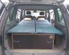 Réalisation sur mesure. Aménagement pour installer un lit et dormir dans son véhicule : sa voiture , son fourgon, son camion par Nomad-Addict.
